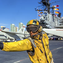 worker on an aircraft carrier